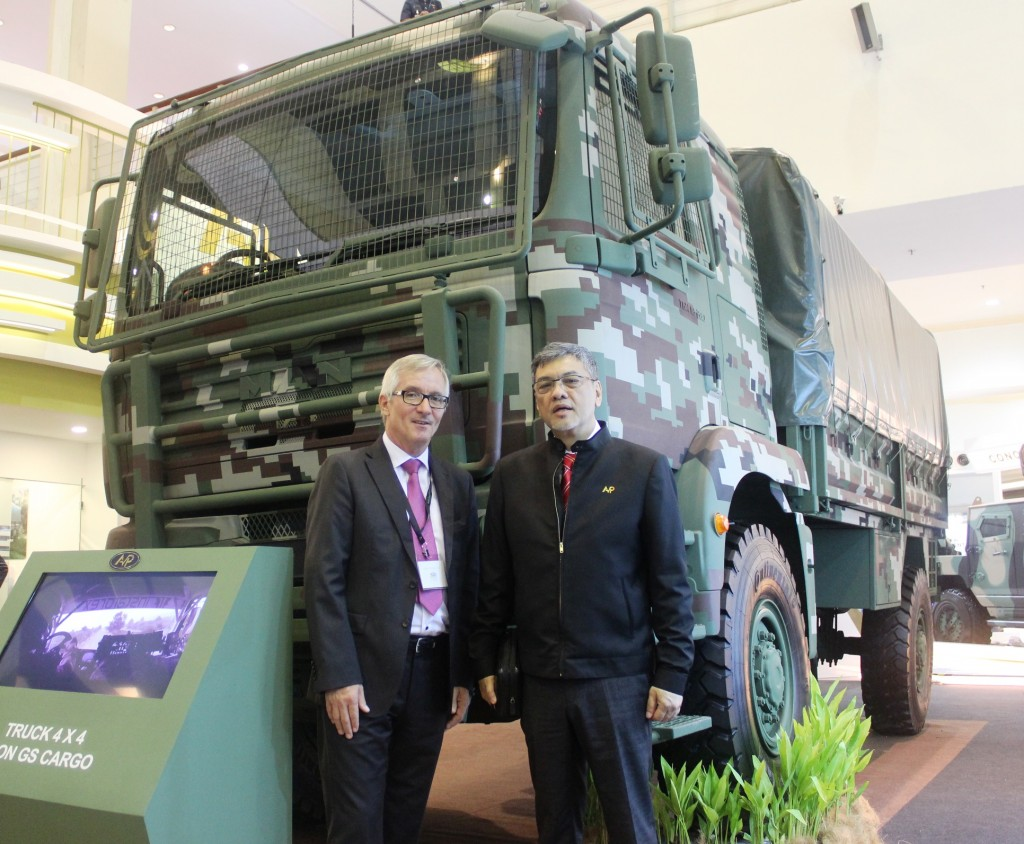 Muller with Tengku Dato' Ardy after the MOU signing at the Defence Services Asia 2016. In the background is MAN truck in military configuration.