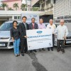 Ford Motor Company's Asia Pacific Emerging Markets managing director BagusSusanto (second from left) and Sime Darby Auto Connexion managing director Syed Ahmad Muzri Syed Faiz (third from left) presenting the vehicles and equipment to Montfort Boys Town.