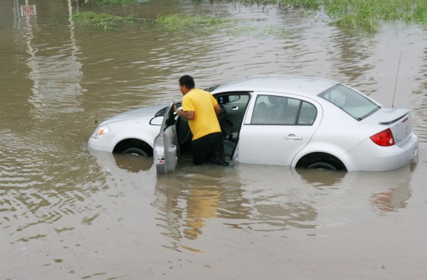 FEMA_-_37218_-_Resident_pushing_a_car_through_flood_waters_in_Texas