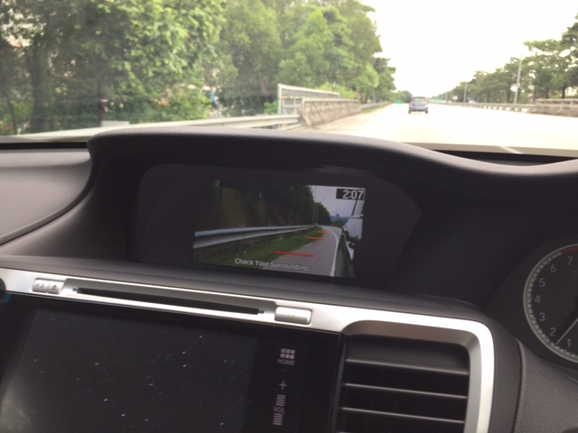 The view of the left side of the vehicle when the left signal is activated.